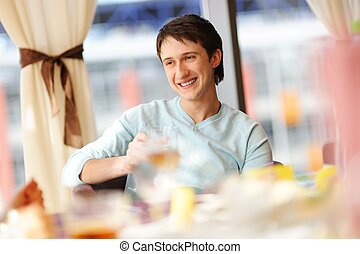 Happy man in a restaurant