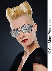 Close-up portrait of a beautiful woman in stylish glasses