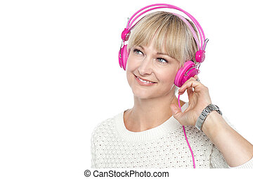 Gorgeous woman listening to music