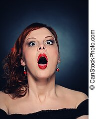 Screaming attractive redhead woman