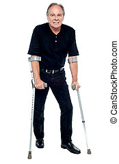 Senior citizen taking his first steps after his successful surgery