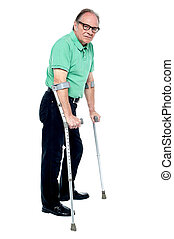 Physically disabled old man with crutches - Physically...