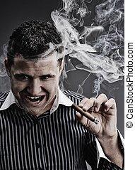 Portrait of a man smoking cigar