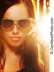 Close-up portrait of a stylish woman in sunglasses