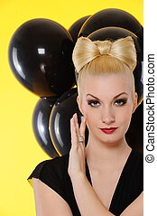 Lovely lady with black balloons