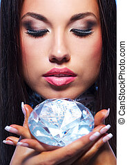 Close-up portrait of a beautiful woman with a diamond