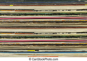 Old record carton covers stacked in pile