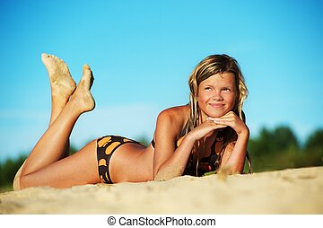 Beautiful young girl relaxing on the beach