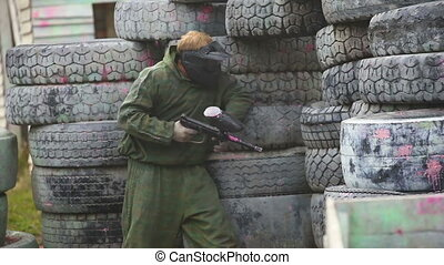 Marksman - A paintball player shooting from behind a cover...