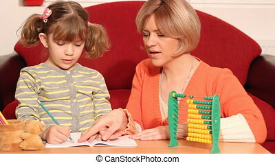 little girl and mother homework