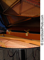 Piano with open cover Strings inside visible like in the...