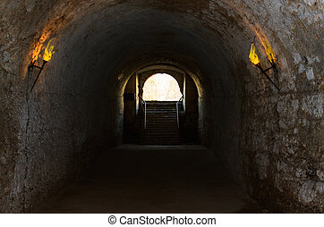 catacombs of the old castle illuminated burning torches