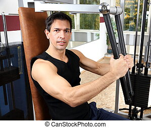 Handsome man working out in a gym