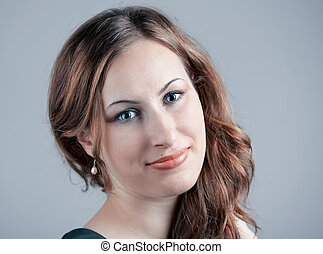 Young woman smiling - Studio portrait of a beautiful 20 year...