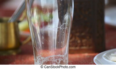 Beer. - Beer being poured into the glass.