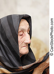 Headscarf - Very old womal looking to her headscarf