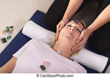 Reiki therapy with girl working as spirit healer, arranging...