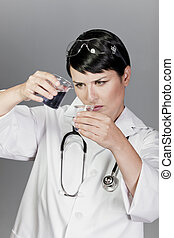 Scientific researcher or doctor looking at a liquid clear solution in a laboratory.