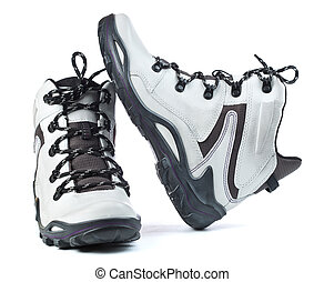 A pair of new white hiking boots on white background - A...