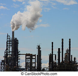 Oil Refinery Blue Sky - Oil refinery smokestacks and towers...