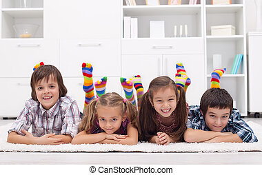 Children with colorful socks - Children laying on the floor...