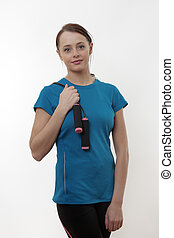 good way to keepfit - woman with a skipping rope over her...