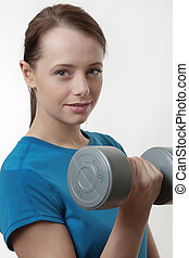 lets keepfit - attractive woman doing a workout routine with...