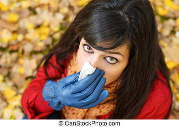 Autumn flu and cold - Sad woman with flu blowing her nose...