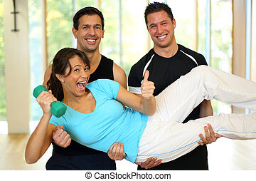 Group having with dumbbells in gym