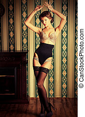 glamour look - Charming young woman in seductive lingerie...