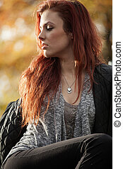 Young Woman with Beautiful Auburn Hair - Young woman looking...
