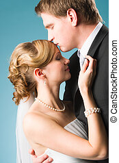 Happy moment - Happy beautiful couple, groom kissing bride...