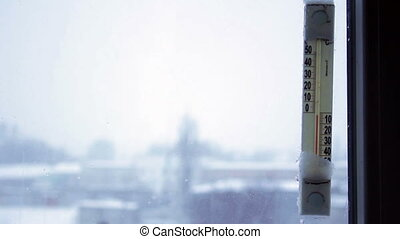 thermometer on the winter window sn