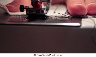 sewing machine sews the seam stitch