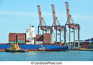 Container stack, ship and tugboat under crane