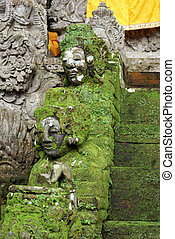 Heads of green demons on the staircase, Bali