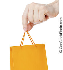 Hand close up with orange shopping bag isolated on white