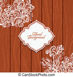 Wooden background with flowers and frame