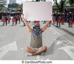 man in street protest