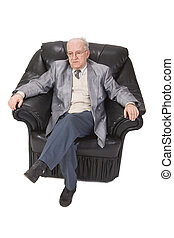 Senior man sitting - Inage of a senior man sitting in an...