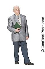 Old teacher - Senior man standing up an holding a book.