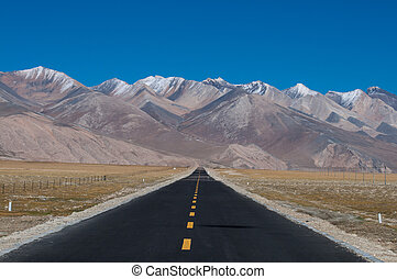 Long way ahead - Long road ahead with mountain in front,...