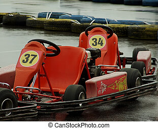 Racing cars on wet asphalt