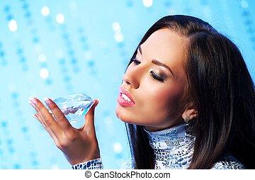 Beautiful brunette woman with diamond
