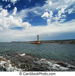 Beautiful lighthouse over blue cloudy sky