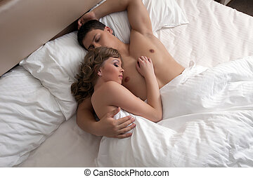 Young couple sleep in bed