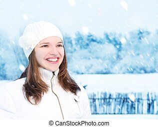 Beautiful young woman in winter clothing outdoors
