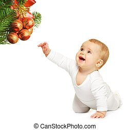 Adorable baby with christmas toy