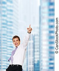 Urban buildings background - Young happy businessman
