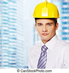 Urban buildings background - Young handsome builder